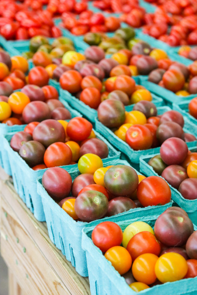 heirloom tomatos at a seasonal produce stand