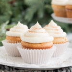 picture of three egg nog cupcakes on white plate