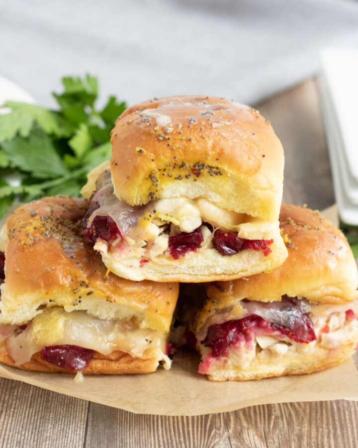 three cranberry turkey sliders baked in the oven.