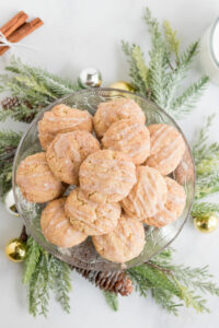 A platter of egg nog cookies surrounded by a christmas wreath