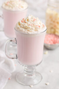 Pink Hot Chocolate in a tall glass mug