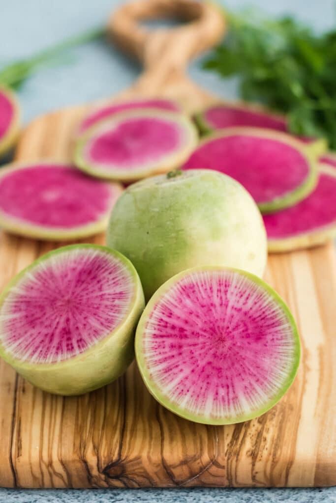 Beautiful watermelon radish sliced open on a cutting board