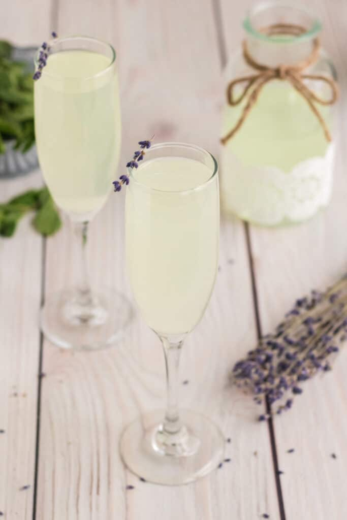 A Lavender Mimosa with a garnish of dried lavender on the rim.