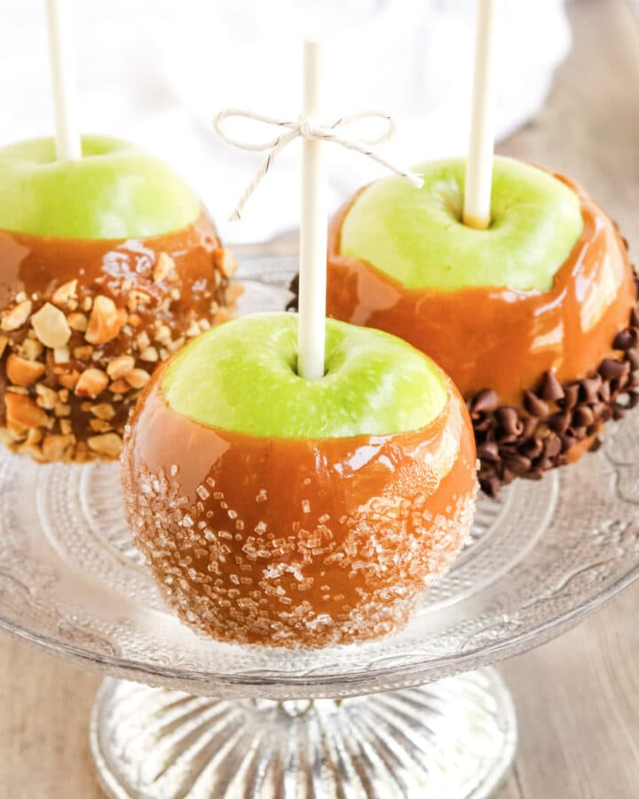 Gourmet caramel apples on a serving platter