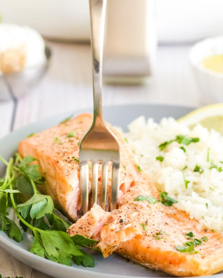 Air Fryer Salmon being flaked with a fork.