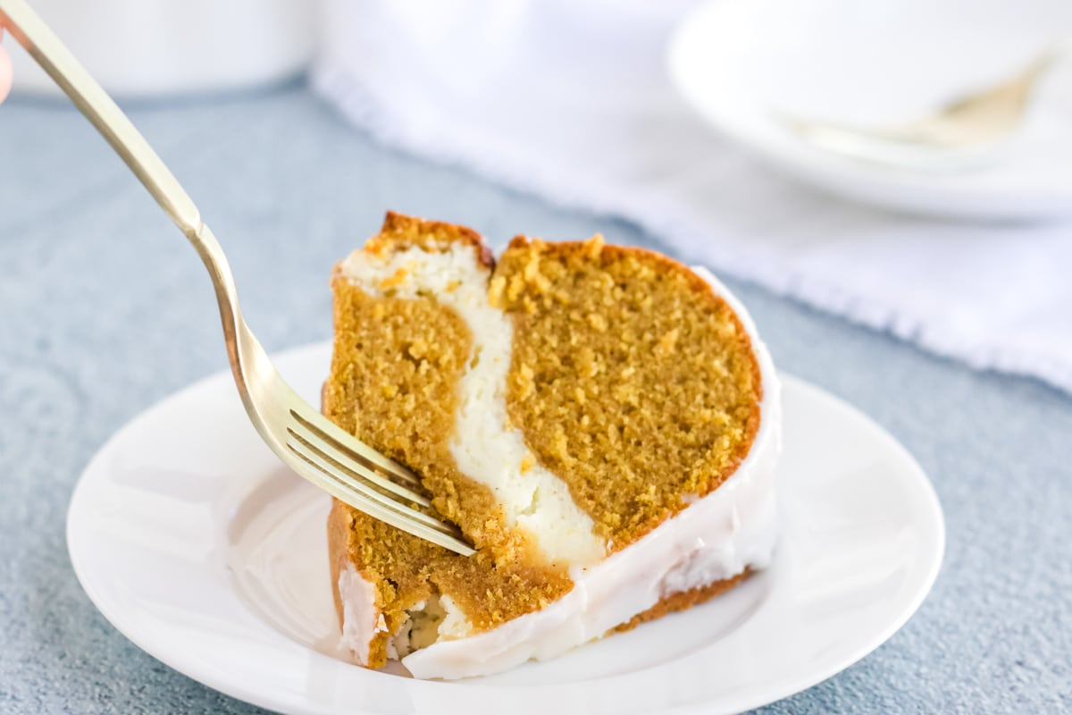 Cream Cheese Pumpkin Pound cake on a white plate.