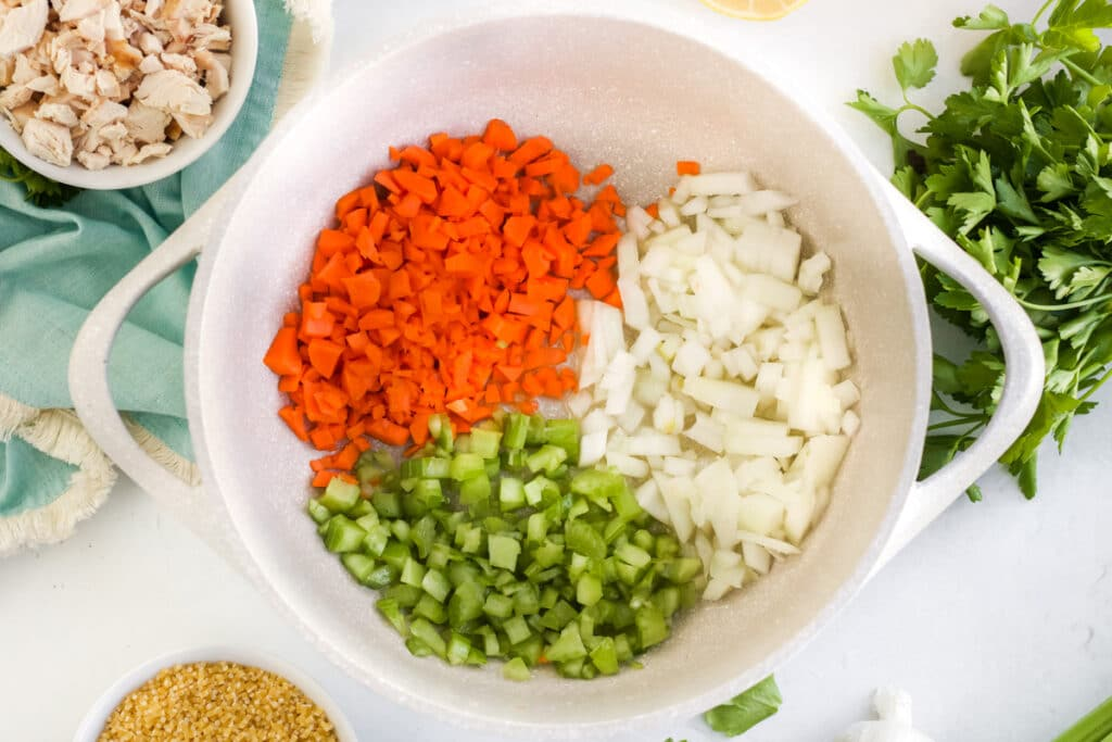 ingredients for chicken pastina soup chopped in a large pot