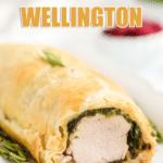 pork wellington on a plate with text that reads savory pork wellington