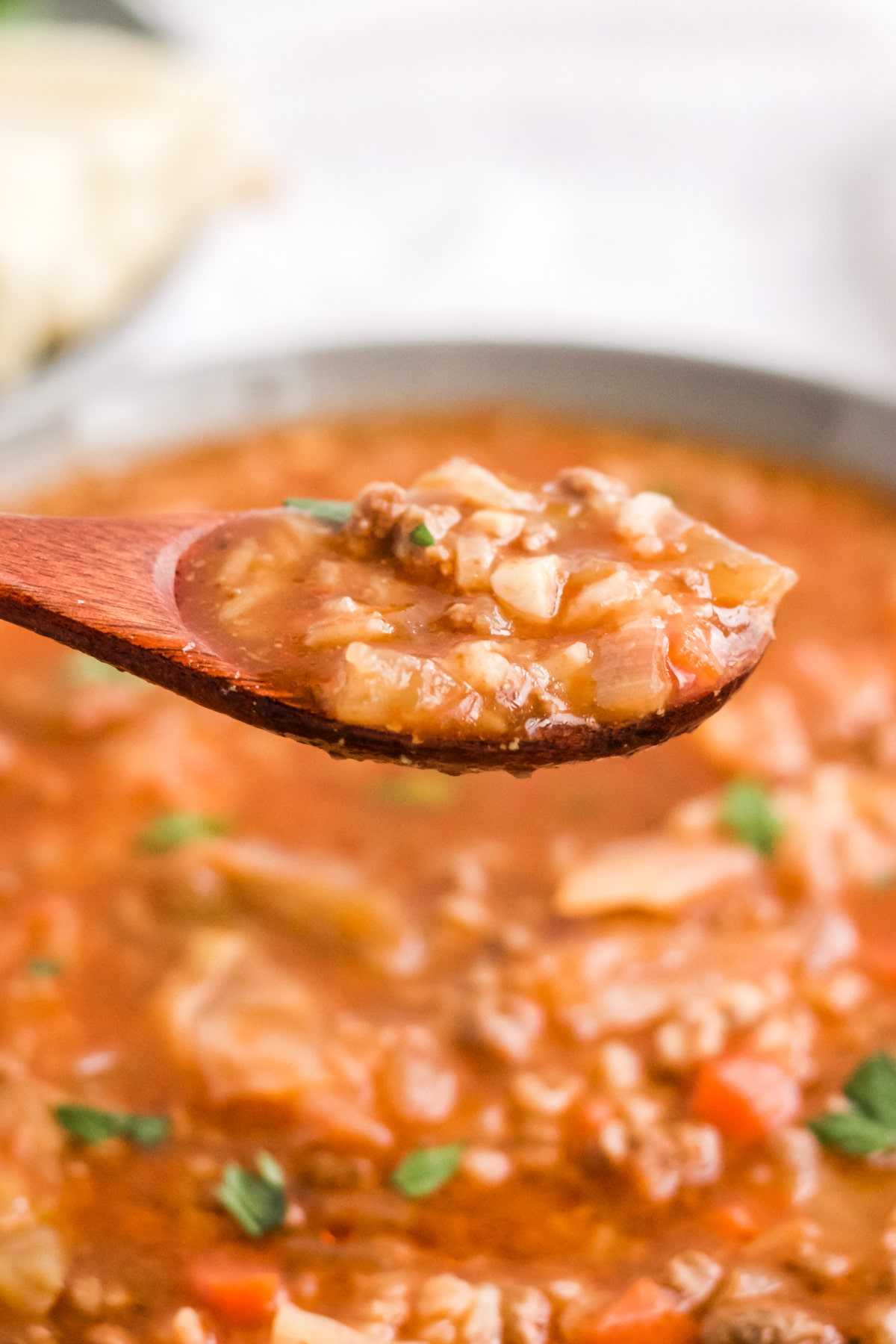 slow cooker cabbage roll soup on a spoon