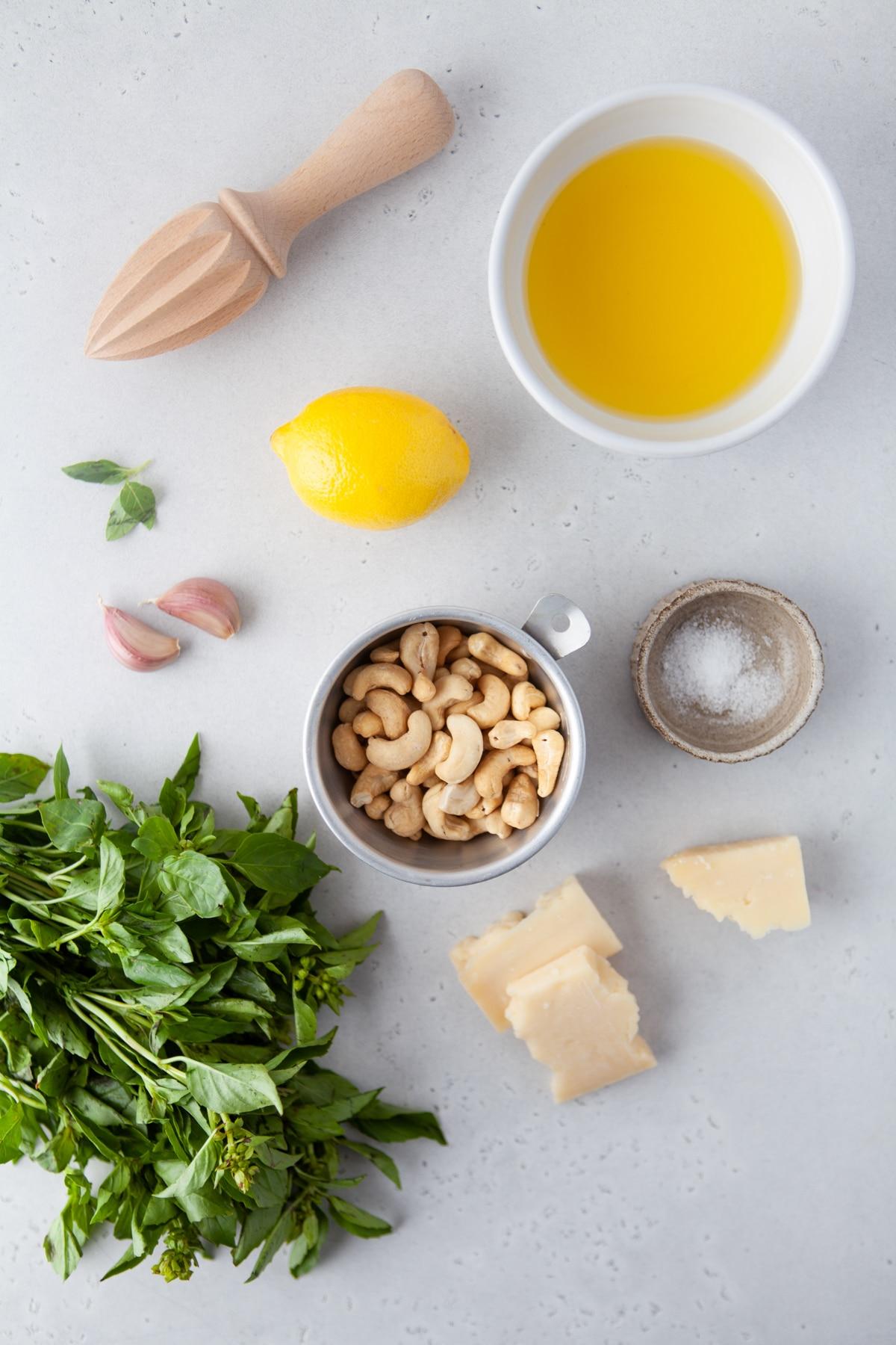 Image of ingredients needed to make cashew pesto sauce.