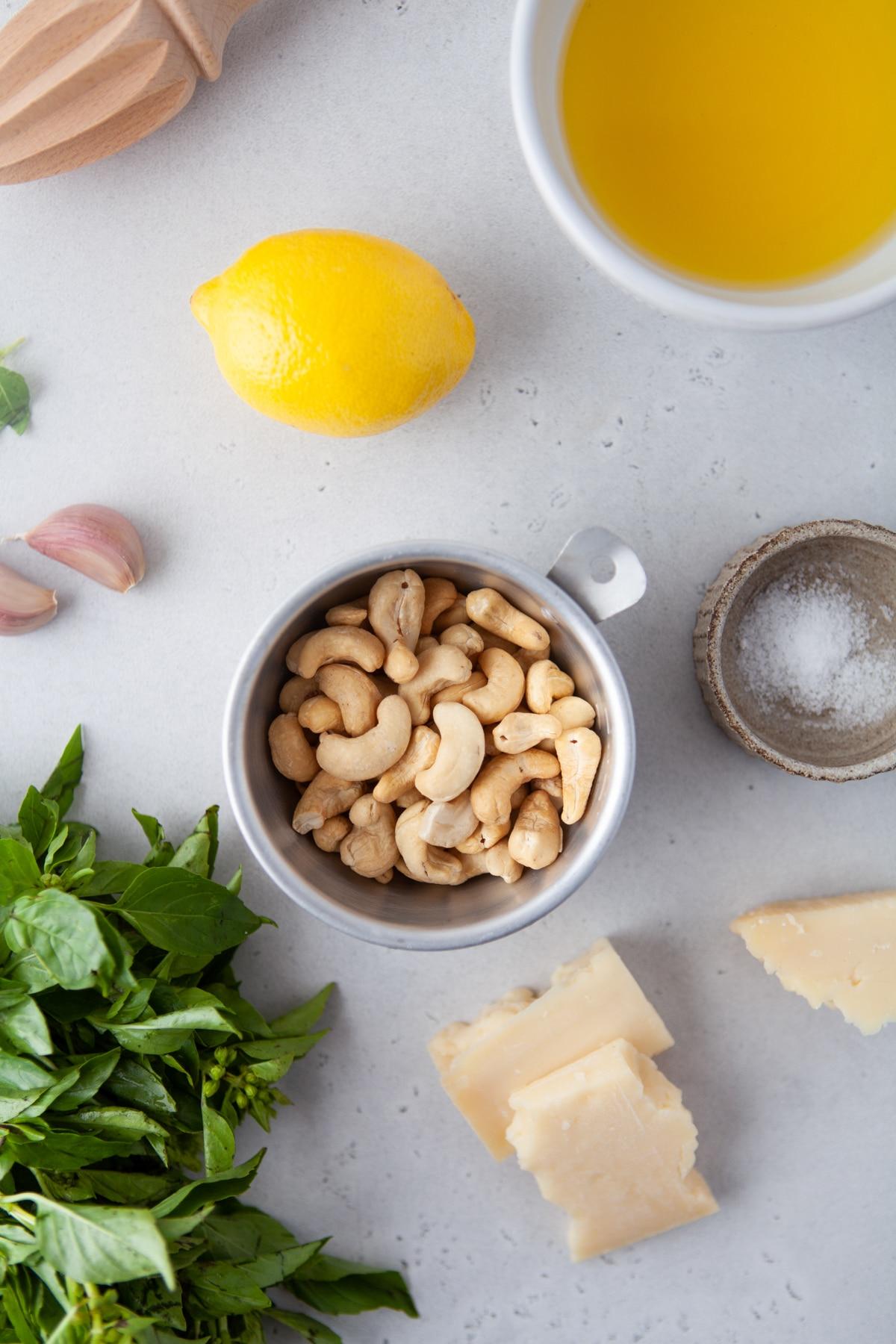 bowl of cashews, fresh basil, lemon, garlic, olive oil, and parmesan cheese