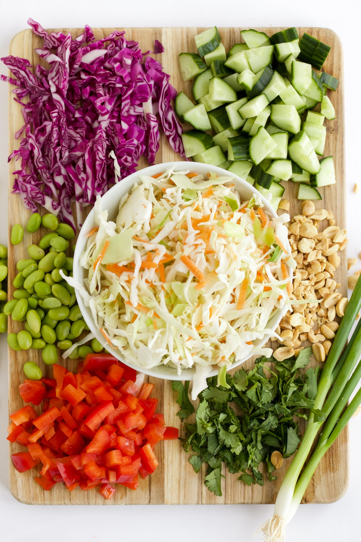 Overhead ingredient image with vegetables to make Thai Salad.