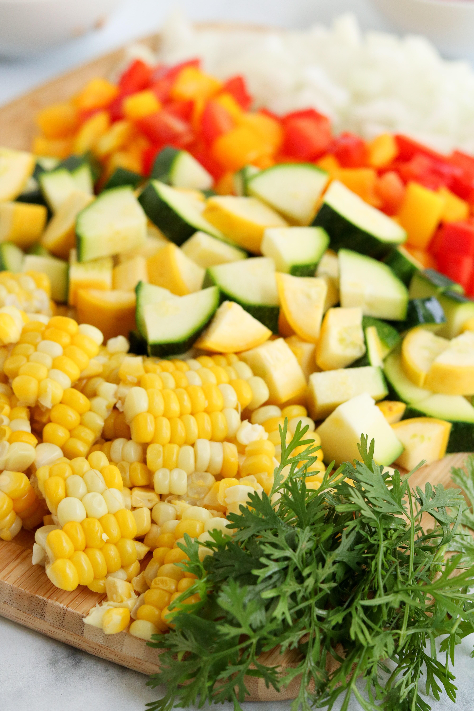 chopped corn, squash, zucchini, bell pepper, onion, and cilantro