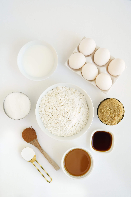 bowls of flour, milk, sugar, apple cider, ground cinnamon, baking soda, and eggs