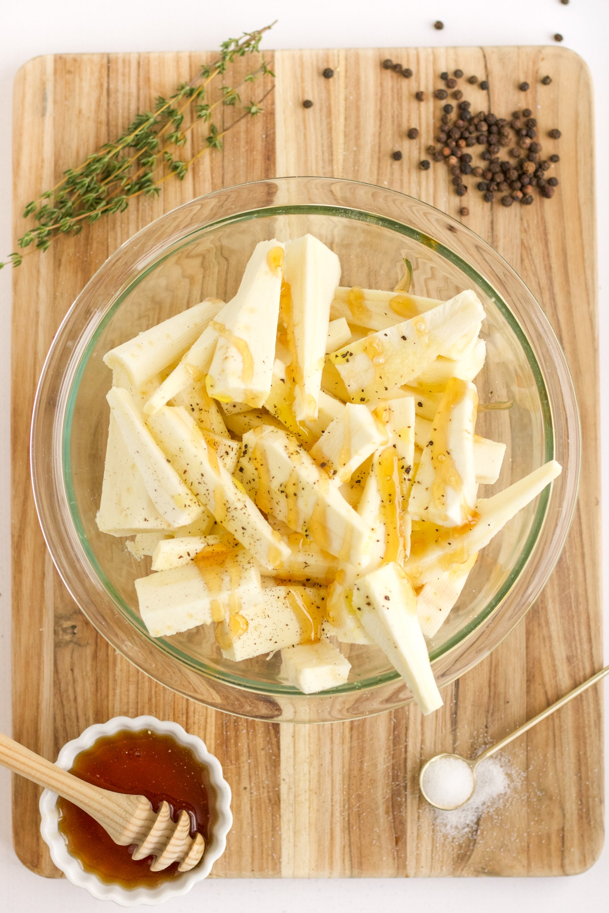 cut parsnips in a glass bowl with other ingredients