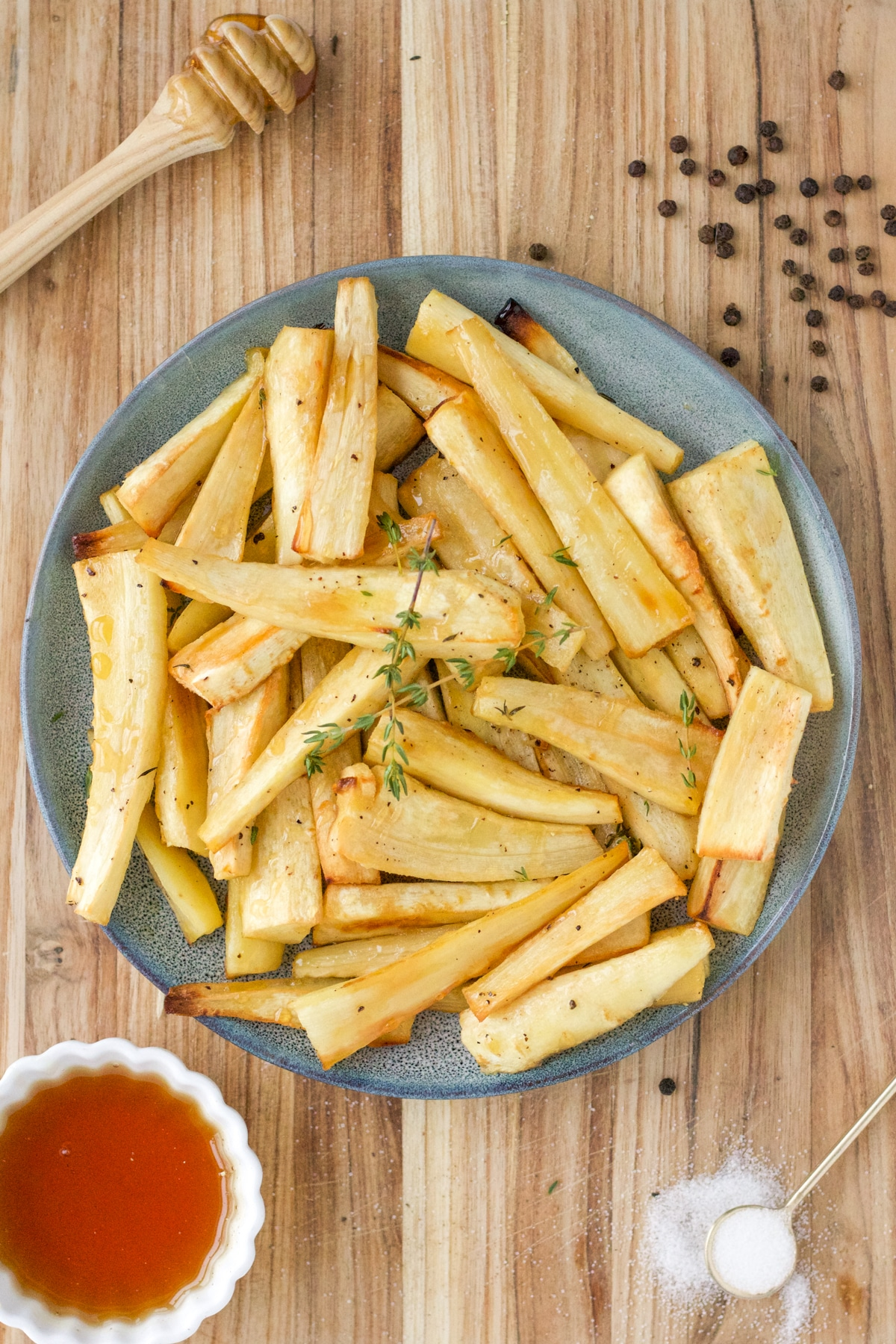 blue plate with honey roasted parsnips