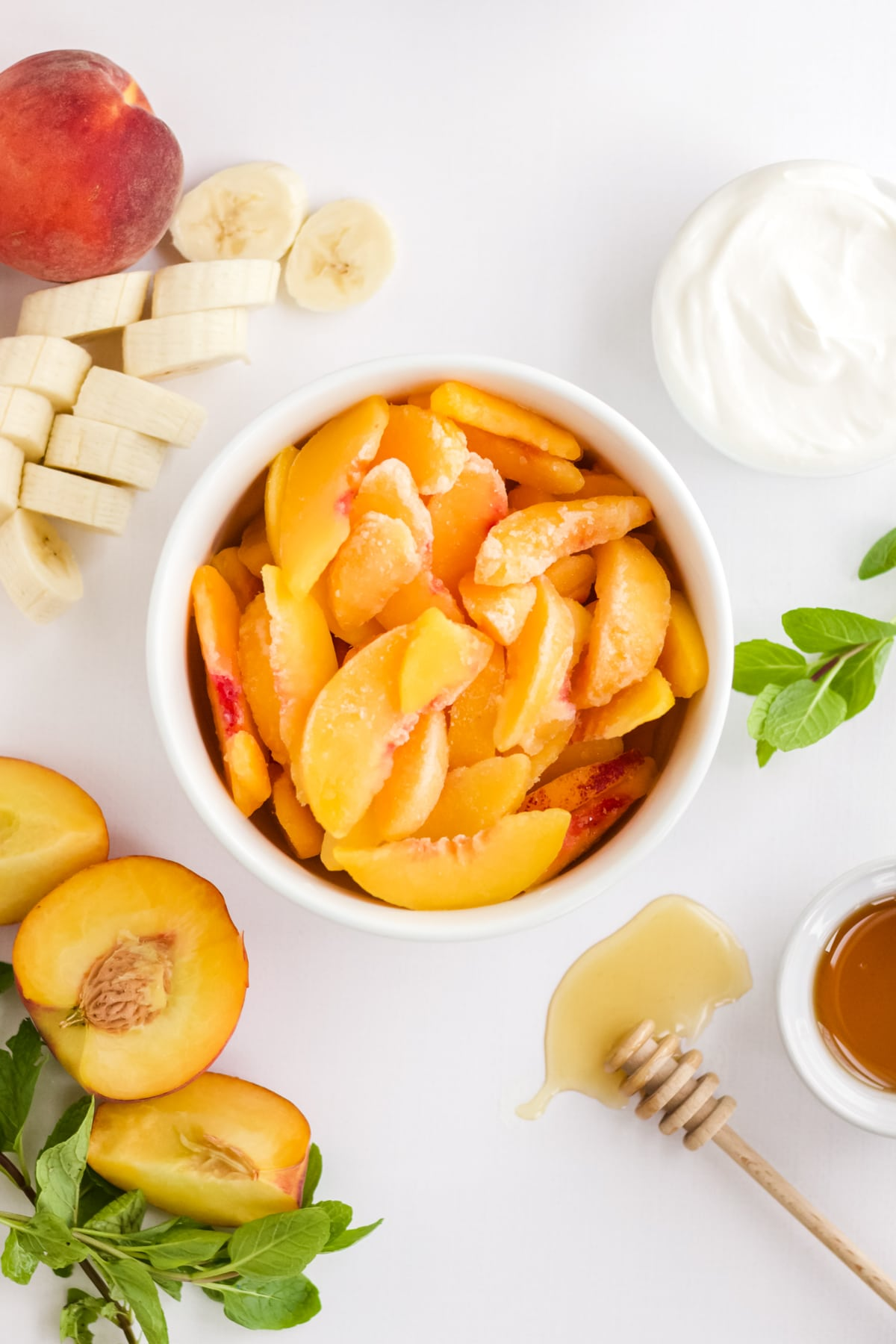 Ingredients to make a peach smoothie